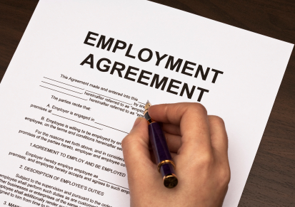 female hands filling out employment agreement contract