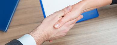 hand shake across desk